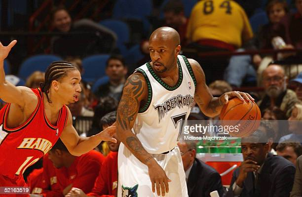 Anthony Carter of the Minnesota Timberwolves is defended by Tyronn Lue of the Atlanta Hawks during the game on January 26 2005 at the Target Center...
