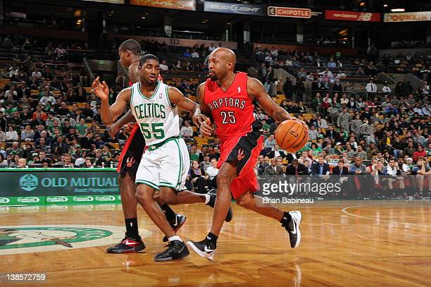 Anthony Carter of the Toronto Raptors drives against E'Twaun Moore of the Boston Celtics on February 1 2012 at the TD Garden in Boston Massachusetts...