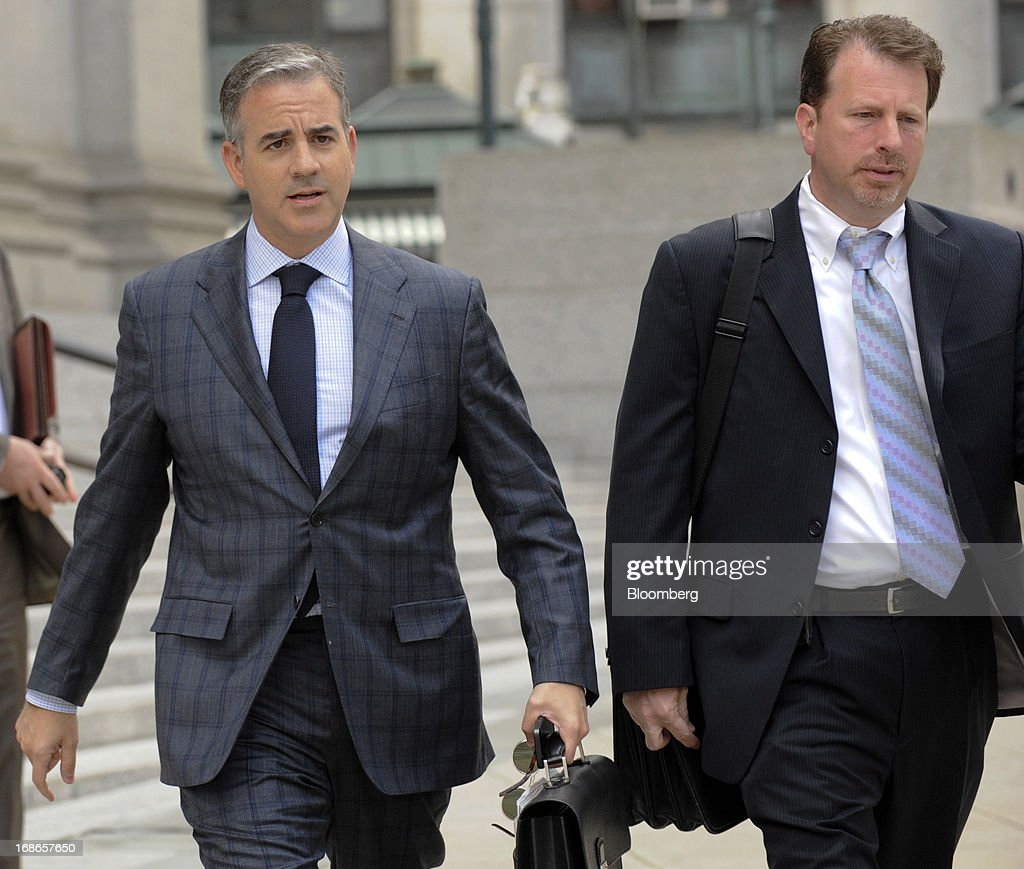Anthony Chiasson, co-founder of Level Global Investors LP, left, exits federal court with his attorney Gregory Morvillo following a sentencing hearing in New York, U.S., on Monday, May 13, 2013. Chiasson will be sentenced to 6 1/2 years in prison for using illegal tips funneled to him from analysts and company insiders to make $68 million for his hedge fund, a judge said. Photographer: Louis Lanzano/Bloomberg via Getty Images