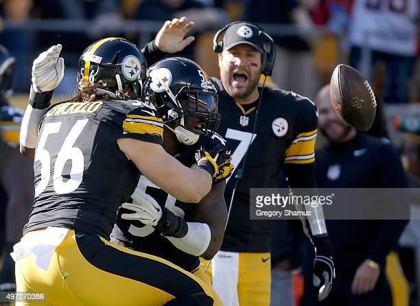 Anthony Chickillo Arthur Moats and Ben Roethlisber of the Pittsburgh Steelers celebrate a fumble recovery by Moats in the 1st quarter of the game...