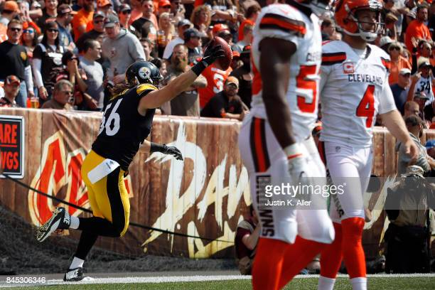 Anthony Chickillo of the Pittsburgh Steelers celebrates after recovering a punt block for a touchdown in the first quarter against the Cleveland...