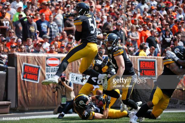 Anthony Chickillo of the Pittsburgh Steelers recover the punt block for a touchdown in the first quarter against the Cleveland Browns at FirstEnergy...