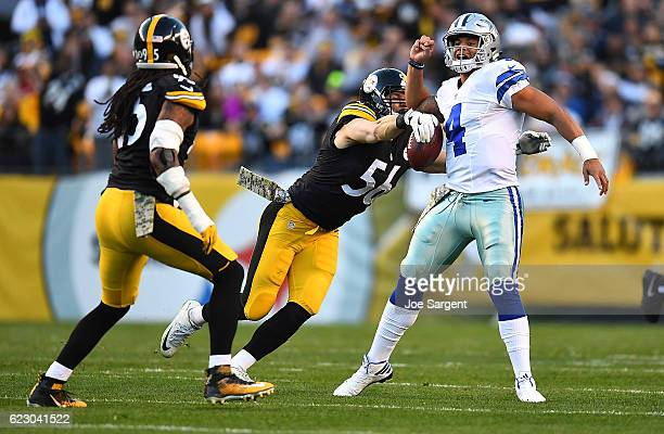 Anthony Chickillo of the Pittsburgh Steelers strips the ball away from quarterback Dak Prescott of the Dallas Cowboys for a fumble in the first...
