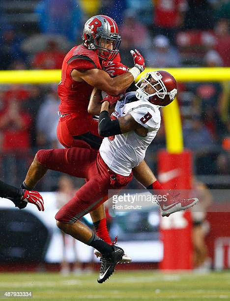 Anthony Cioffi of the Rutgers Scarlet Knights wrestles the ball out of the hands of Gabe Marks of the Washington State Cougars forcing an incomplete...