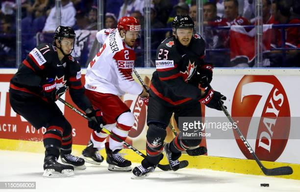 Anthony Cirelli and Sam Reinhart of Canada challenge Phillip Bruggisser of Denmark during the 2019 IIHF Ice Hockey World Championship Slovakia group...