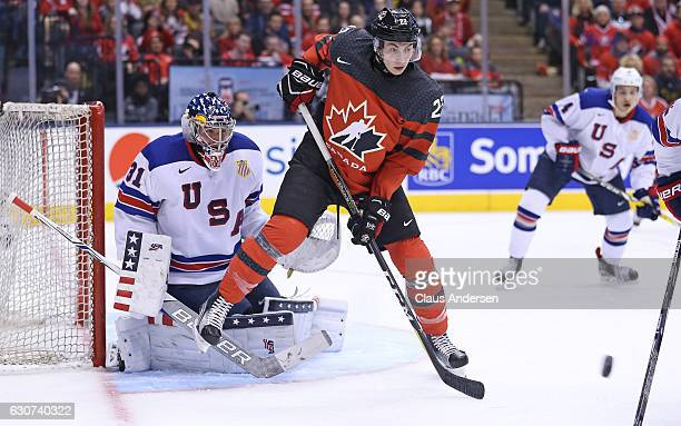 Anthony Cirelli of Team Canada gets set to deflect a shot at Joseph Wall of Team USA during a preliminary round game in the 2017 IIHF World Junior...