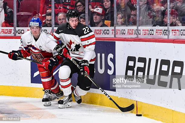 Anthony Cirelli of Team Canada skates the puck against Filip Hronek of Team Czech Republic during the 2017 IIHF World Junior Championship...