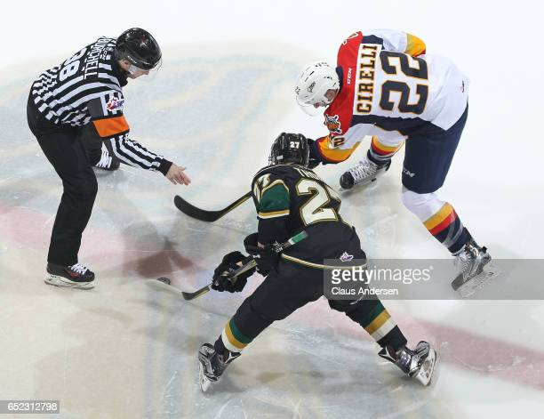 Anthony Cirelli of the Erie Otters takes a faceoff against Robert Thomas of the London Knights during an OHL game at Budweiser Gardens on March 10...