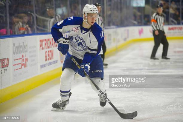 Anthony Cirelli of the Syracuse Crunch brings the puck up ice during a game against the Bridgeport Sound Tigers at the Webster Bank Arena on February...