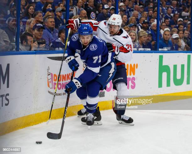 Anthony Cirelli of the Tampa Bay Lightning against Christian Djoos of the Washington Capitals during Game Five of the Eastern Conference Final during...