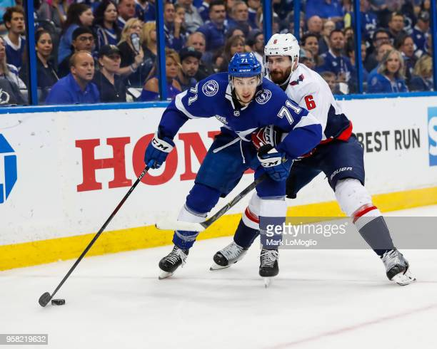 Anthony Cirelli of the Tampa Bay Lightning against Michal Kempny of the Washington Capitals during Game Two of the Eastern Conference Final during...