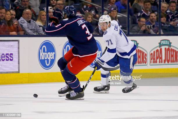Anthony Cirelli of the Tampa Bay Lightning attempts to skate the puck past Seth Jones of the Columbus Blue Jackets during the game on February 18...