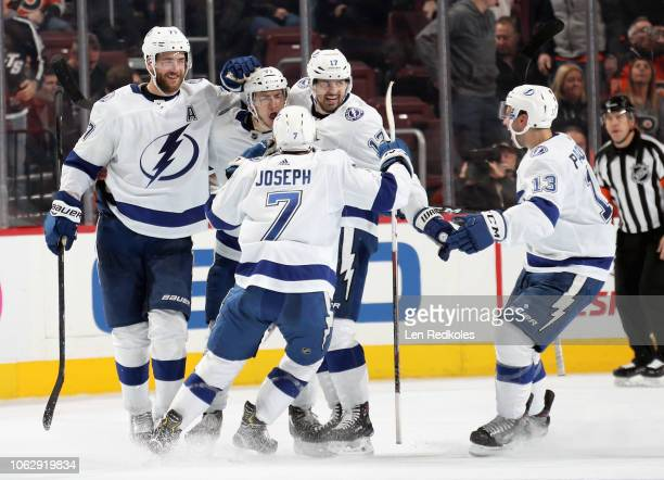 Anthony Cirelli of the Tampa Bay Lightning celebrates his gamewinning overtime goal against the Philadelphia Flyers with teammates Victor Hedman Alex...
