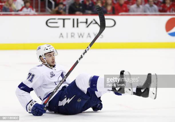 Anthony Cirelli of the Tampa Bay Lightning falls to the ice in the third period against the Washington Capitals in Game Six of the Eastern Conference...
