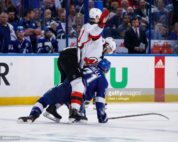 Anthony Cirelli of the Tampa Bay Lightning gets tangled up with Stefan Noesen of the New Jersey Devils in Game Two of the Eastern Conference First...