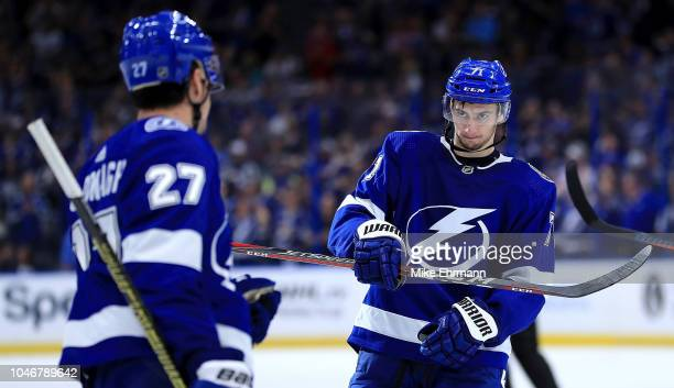 Anthony Cirelli of the Tampa Bay Lightning is congratulated after scoring a goal in the third period during Opening Night against the Florida...