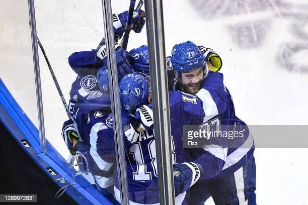 Anthony Cirelli of the Tampa Bay Lightning is congratulated by his teammates after scoring a goal against the Boston Bruins during the third period...