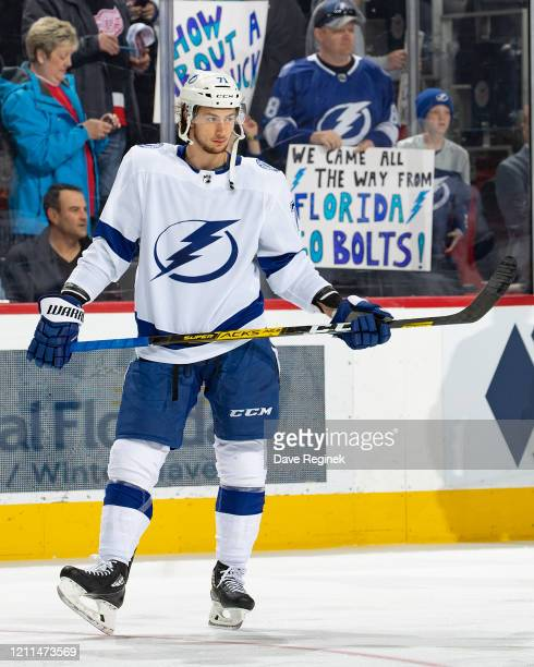Anthony Cirelli of the Tampa Bay Lightning looks down the ice in warm ups prior to an NHL game against the Detroit Red Wings at Little Caesars Arena...
