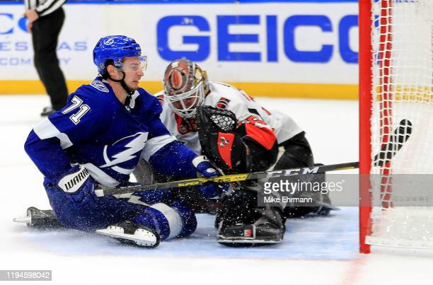 Anthony Cirelli of the Tampa Bay Lightning scores the game winning goal in overtime on Marcus Hogberg of the Ottawa Senators during a game at Amalie...