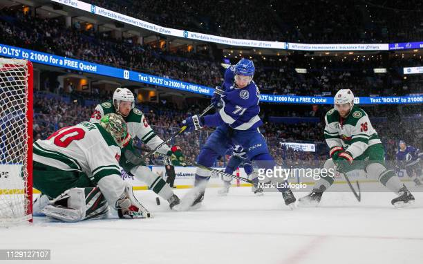 Anthony Cirelli of the Tampa Bay Lightning shoots the puck against goalie Devan Dubnyk of the Minnesota Wild at Amalie Arena on March 7 2019 in Tampa...