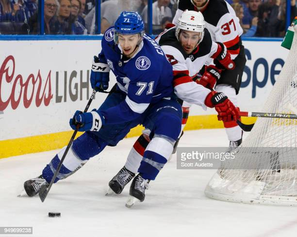 Anthony Cirelli of the Tampa Bay Lightning skates against John Moore of the New Jersey Devils in Game Five of the Eastern Conference First Round...