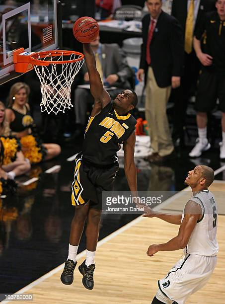 Anthony Clemmens of the Iowa Hawkeyes dunks over Adreian Payne of the Michigan State Spartans during a quarterfinal game of the Big Ten Basketball...