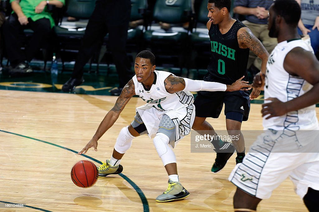 Anthony Collins #11 of the South Florida Bulls advances the ball against the Notre Dame Fighting Irish during the game at the Sun Dome on January 26, 2013 in Tampa, Florida.