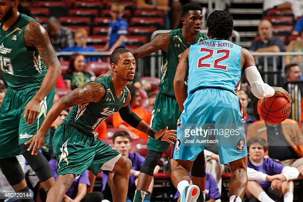 Anthony Collins of the South Florida Bulls defends against Xavier RathanMayes of the Florida State Seminoles during the MetroPCS Orange Bowl...
