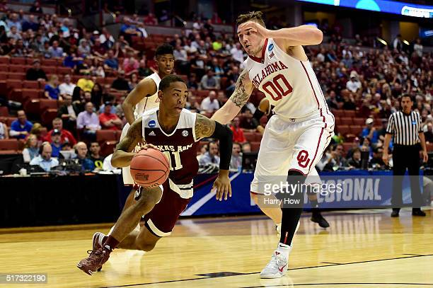 Anthony Collins of the Texas AM Aggies drives on Ryan Spangler of the Oklahoma Sooners in the first half in the 2016 NCAA Men's Basketball Tournament...