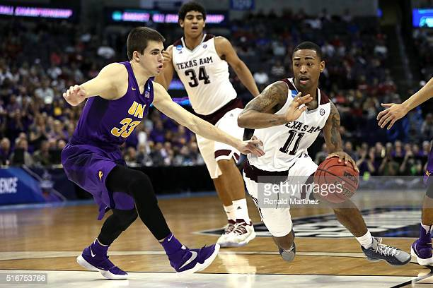 Anthony Collins of the Texas AM Aggies drives to the basket against Wyatt Lohaus of the Northern Iowa Panthers during the second round of the 2016...
