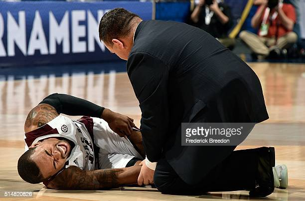 Anthony Collins of the Texas AM Aggies grimaces after falling to the court during the first half of an SEC Tournament Quarterfinal game against the...
