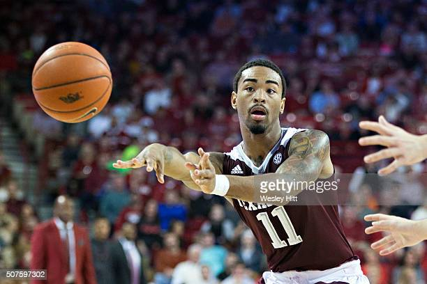 Anthony Collins of the Texas AM Aggies makes a pass during a game against the Arkansas Razorbacks at Bud Walton Arena on January 27 2016 in...