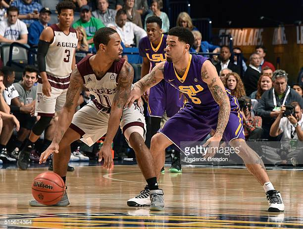 Anthony Collins of the Texas AM Aggies plays against Josh Gray of the LSU Tigers SEC Basketball Tournament Semifinals game at Bridgestone Arena on...