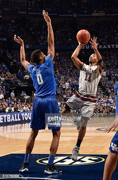 Anthony Collins of the Texas AM Aggies takes a shot against Marcus Lee of the Kentucky Wildcats during the SEC Basketball Tournament Championship at...