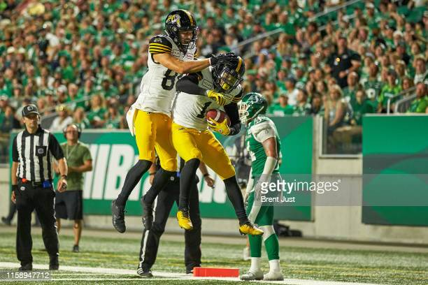 Anthony Coombs and Jaelon Acklin of the Hamilton TigerCats celebrate a touchdown in the game between the Hamiton TigerCats and Saskatchewan...