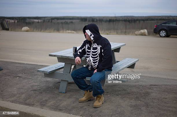 Anthony Cormier smokes outside a camp for migrant oil sands workers on April 29th north of Fort McMurray Canada Cormier is a scaffolder and carpenter...