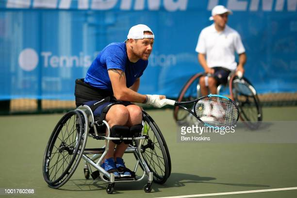 Anthony Cotterill of Great Britain serves during his quad doubles semi final against Shota Kawano of Japan and Ymanitu Silva of Brazil on day three...