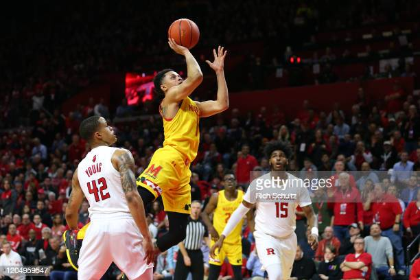 Anthony Cowan Jr #1 of the Maryland Terrapins attempts a shot as Jacob Young and Myles Johnson of the Rutgers Scarlet Knights defend during the first...