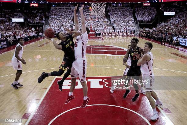 Anthony Cowan Jr #1 of the Maryland Terrapins attempts a shot while being guarded by Nate Reuvers of the Wisconsin Badgers in the first half at the...