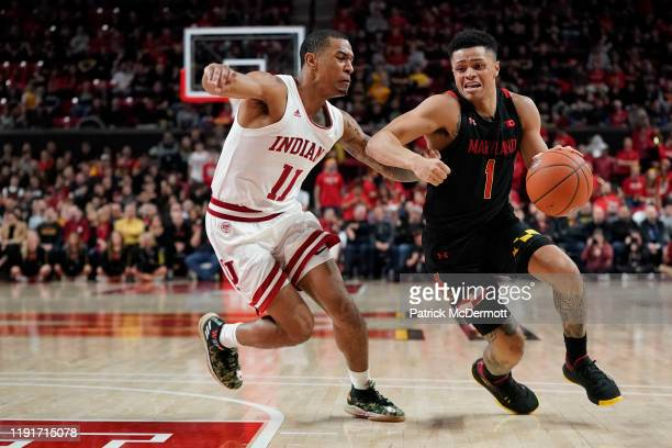 Anthony Cowan Jr #1 of the Maryland Terrapins dribbles as Devonte Green of the Indiana Hoosiers defends in the second half at Xfinity Center on...