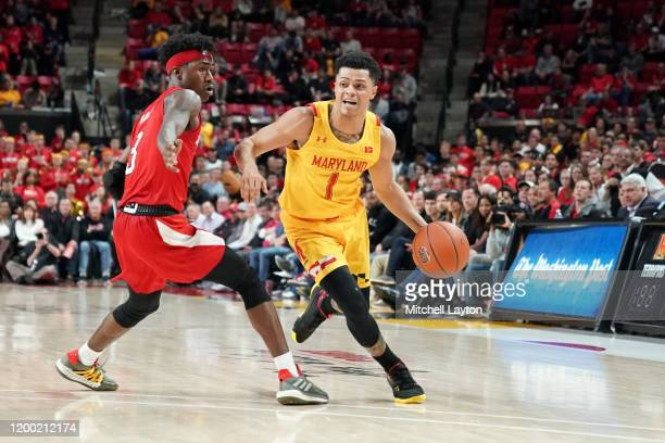 Anthony Cowan Jr #1 of the Maryland Terrapins dribbles by Cam Mack of the Nebraska Cornhuskers in the second half during a college basketball game at...