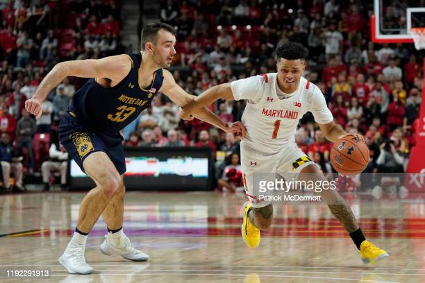 Anthony Cowan Jr #1 of the Maryland Terrapins dribbles the ball against John Mooney of the Notre Dame Fighting Irish in second half at Xfinity Center...