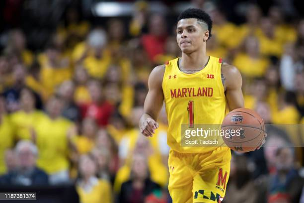Anthony Cowan Jr #1 of the Maryland Terrapins dribbles the ball against the Illinois Fighting Illini during the second half at Xfinity Center on...