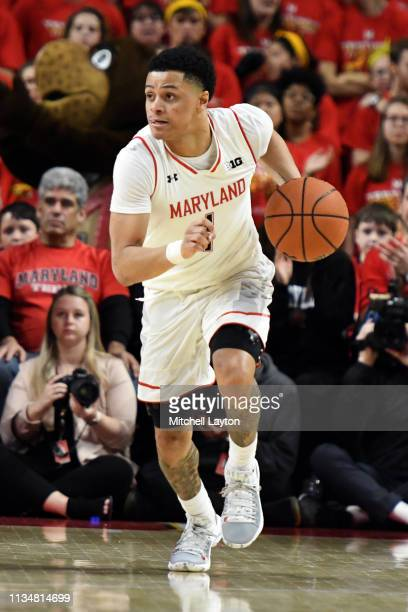 Anthony Cowan Jr #1 of the Maryland Terrapins dribbles up court during a college basketball game against the Michigan Wolverines at the XFinity...