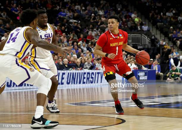 Anthony Cowan Jr #1 of the Maryland Terrapins drives against Marlon Taylor of the LSU Tigers during the first half of the game in the second round of...