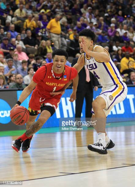 Anthony Cowan Jr #1 of the Maryland Terrapins drives against Skylar Mays of the LSU Tigers during the second half of the game in the second round of...