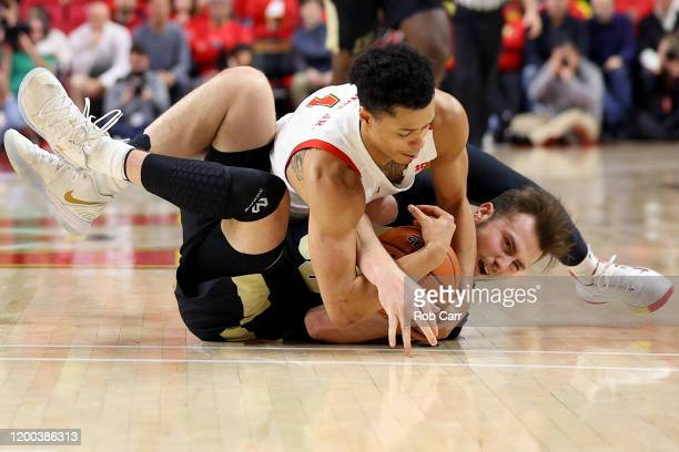 Anthony Cowan Jr. #1 of the Maryland Terrapins fouls Sasha Stefanovic of the Purdue Boilermakers while going after a loose ball in the second half at...