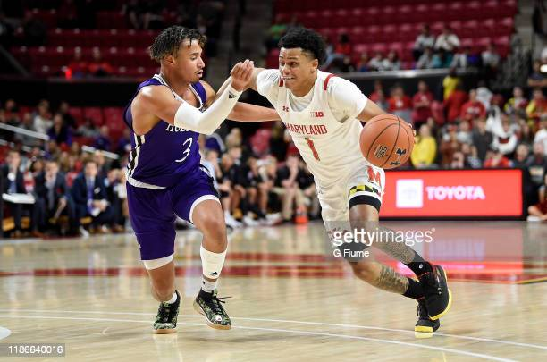 Anthony Cowan Jr #1 of the Maryland Terrapins handles the ball against Drew Lowder of the Holy Cross Crusaders at Xfinity Center on November 5 2019...