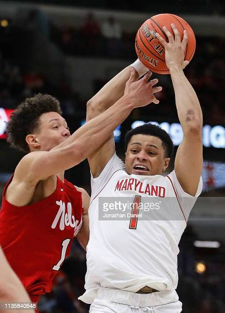 Anthony Cowan Jr #1 of the Maryland Terrapins is fouled by Isaiah Roby of the Nebraska Cornhuskers at the United Center on March 14 2019 in Chicago...