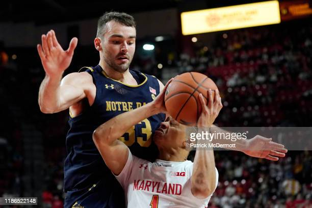 Anthony Cowan Jr #1 of the Maryland Terrapins is fouled by John Mooney of the Notre Dame Fighting Irish in the second half at Xfinity Center on...